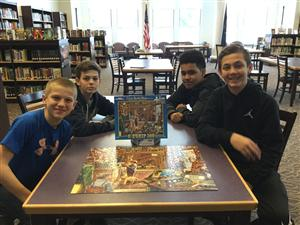 7th graders with their completed puzzle